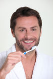 A man brushing his teeth Royalty Free Stock Images