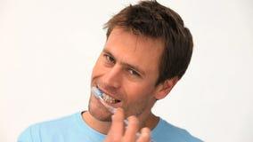 A man brushing his teeth stock video footage