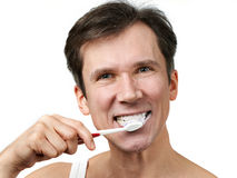 Man brushing his teeth Royalty Free Stock Images
