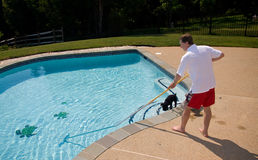 Man brushing pool Royalty Free Stock Images