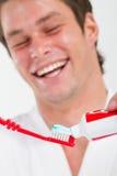 Man brushing teeth Stock Images