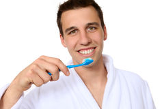 Man Brushing Teeth. A handsome young man brushing his teeth stock photos