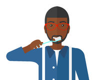 Man brushing teeth Royalty Free Stock Images