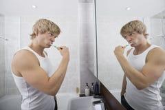 Man brushing teeth in bathroom Royalty Free Stock Photos