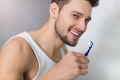 Man brushing teeth Royalty Free Stock Photography