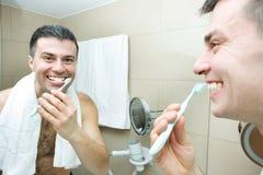 Man brushing teeth Royalty Free Stock Images