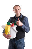 Man with bucket full of cleaning products Stock Photography