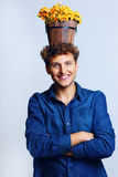 Man with a bucket on his head with flowers Royalty Free Stock Photography