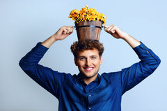 Man with a bucket on his head with flowers Royalty Free Stock Image