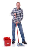Man with bucket and mop. Full isolated studio picture from a young man with a bucket and a cleaning mop royalty free stock images