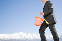 Man with bucket and spade near mountains Stock Photography