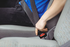 Man buckling his seatbelt Royalty Free Stock Image