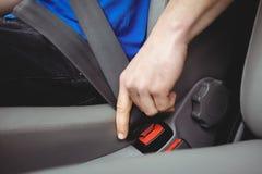 Man buckling his seatbelt Stock Photography