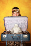 Man with Buddha in suitcase Royalty Free Stock Images