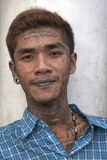 Man with buddhist religious tattoos from Thailand royalty free stock images