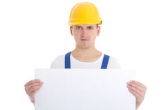 Man builder in blue uniform and helmet holding paper with copy s Stock Photos