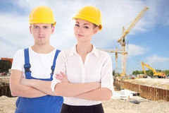 Man builder and business woman architect in helmet Stock Photography
