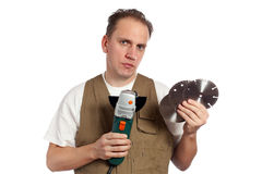 The man, the builder, chooses a detachable disk Royalty Free Stock Photo