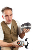 The man, the builder, chooses a detachable disk Stock Image