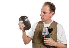 The man, the builder, chooses a detachable disk fo Royalty Free Stock Image