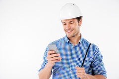 Man builder in hard hat using mobile phone Royalty Free Stock Images