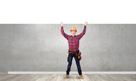 Man builder presenting something Royalty Free Stock Images