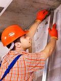 Man in builder uniform. Stock Photo