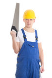 Man in builder uniform and helmet with manual saw isolated on wh Royalty Free Stock Image
