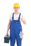 Man in builder uniform and helmet with toolbox thumbs up isolate Stock Photography