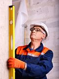 Man in builder uniform. Stock Photo