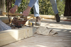 Man Building a Deck Stock Photo