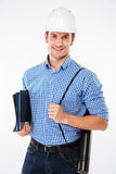 Man building engineer in hard hat holding folders and blueprints. Happy young man building engineer in hard hat holding folders and blueprints royalty free stock photo