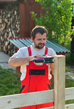 Man building a fence Stock Images