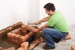 Man building fireplace Royalty Free Stock Photo