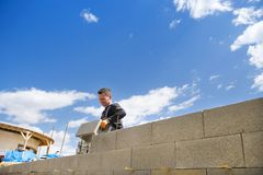 Man building a house Stock Images
