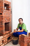 Man building a masonry heater Stock Photography