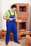 Man building masonry heater Royalty Free Stock Images