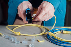 Man building networking data cable Stock Photography
