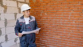 Man with building plans exploring room royalty free stock images