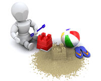 Man building sandcastle with bucket and spade Royalty Free Stock Photos