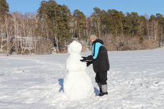 The man building a snowman Stock Photography