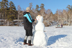 The man building a snowman Stock Photos