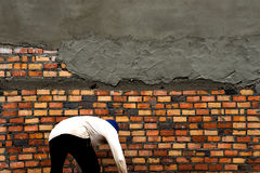 man building wall Stock Image