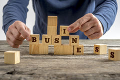 Man building the word Business with blocks Stock Images