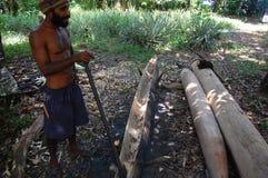 Man builds canoe Stock Image