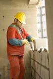 Man Builds Cinder Block Wall - Vertical Stock Photography