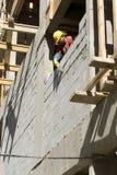 Man Builds Cinder Block Wall - Vertical Stock Photo