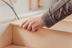 Man builds furniture in the carpentry shop. Stock Images