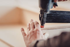 Man builds furniture in the carpentry shop. Stock Photography