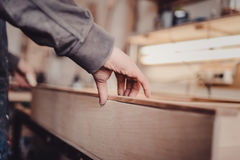 Man builds furniture in the carpentry shop. Royalty Free Stock Image